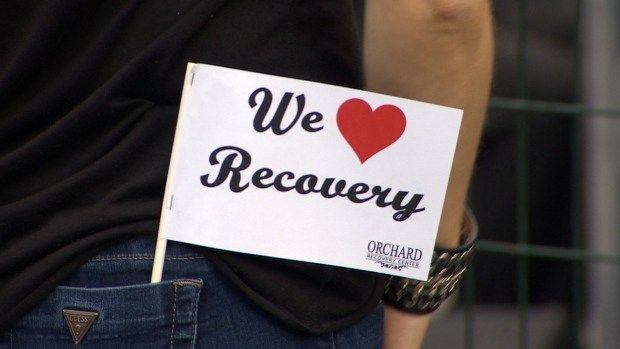Orchard Recovery Center flags handed out to attendees of the 2016 Recovery Day.