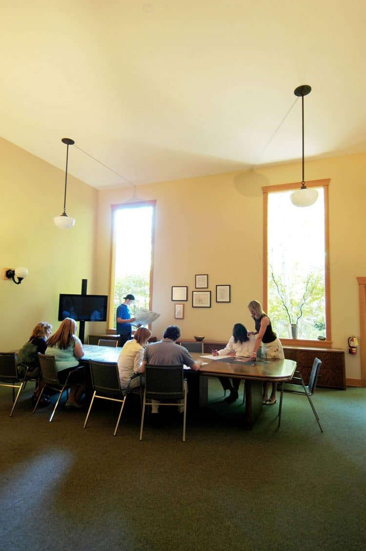 Clients working in the large group room at Orchard Recovery Center