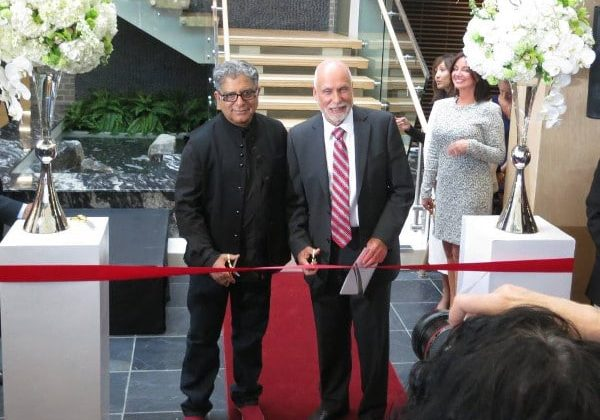 John Volken (right) invited philosopher and writer Deepak Chopra to speak at the grand opening of the John Volken Academy in 2015. Photo Charlie Smith