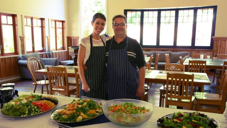 Kitchen Manager Kim Molinski and Chef Gord Hedge showing off delicious salads in the Orchard Recovery Center dining room