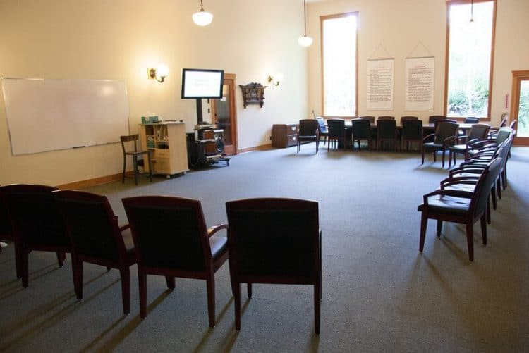 Clients start off the morning programming in Orchard Recovery Center's large group room
