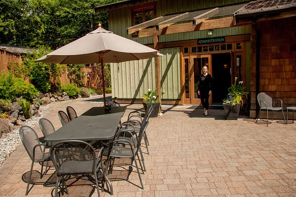 Orchard Recovery Center Administration courtyard has tables where the clients can relax in the sun